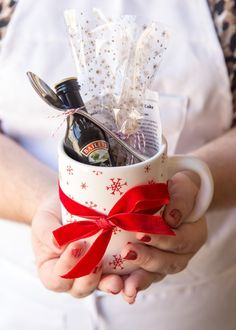 Stumped on what to bring for your office secret Santa or white elephant gift exchange? Don't just bring another coffee mug—make a mug cake kit! It's super simple, under $10, and when you add a nip of Baileys, you're sure to win at the holidays.