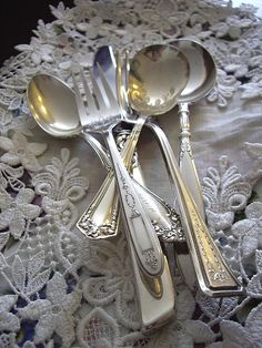 Old silver and embroidered linens