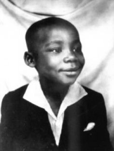 """Image of Dr. Martin Luther King Jr as a child.    """"Intelligence plus character--that is the goal of true education.""""  - Martin Luther King, Jr."""