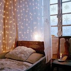 Dim string light in sheer sheet/curtiain wrap around the bed. Makes for a starry night meets princess bed! This is so pretty and quaint!