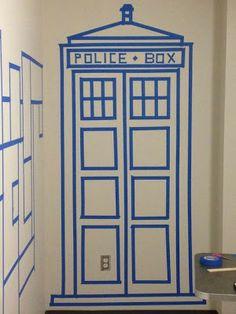 Painters tape TARDIS - this is a brilliant idea for decorating dorm walls! BRB, got to go to Home Depot and pick me up some painters tape. Tardis Door, The Tardis, Dorm Room Doors, Dorm Walls, Attic Renovation, Attic Remodel, Dr Who, Doctor Who Party, Geek Chic