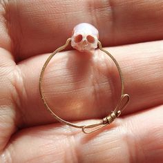 Miniature Skulls Carved from Pearls Used to Create Anatomical Jewelry