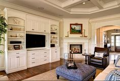 The trim, ceiling and cabinetry are painted in Sherwin Williams Shell White, and the walls are Sherwin Williams, Patience 7555. The mosaic around the fireplace is a natural travertine tile from Dal-Tile