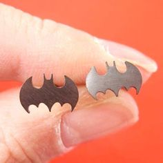 - Description - Details If you're a fan of Batman you'll love these batman bat shaped stud earrings in dark silver! They are made with titanium allergy free earring posts! We have more Batman themed j
