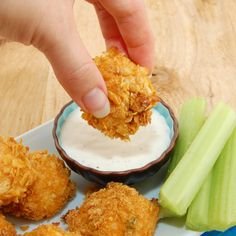 Buffalo Chicken bites  Ingredients:  3 cups shredded cooked chicken  1/4 to 1/2 cup hot sauce (to taste)  3 1/2 ounces cream cheese, softened  1 3/4 cups sharp shredded cheddar cheese  1/4 cup chopped green onions  1 cup all-purpose flour  4 eggs, lightly beaten  3 – 4 cups Corn Flakes cereal, crushed