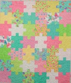 I like this pattern, but in more boyish reds and blues would be cool!    Pretty Puzzle Quilt (includes pattern), by craftylady.com.au