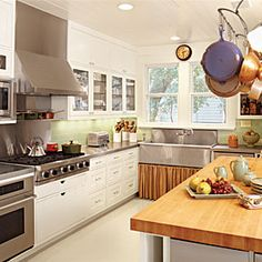 Kitchen Colors- chef's white kitchen with lots of contrast including stainless steel countertop