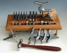 These are Fretz hammers and stakes used to manipulate metal.  I have these and they are absolutely wonderful!!