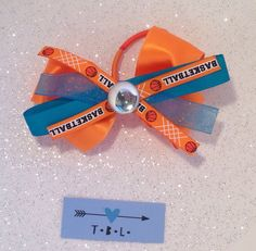 A personal favorite from my Etsy shop https://www.etsy.com/listing/398757981/orange-and-blue-basketball-bow