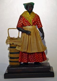 Francisco Vargas, Sr., (born 1825; active New Orleans 1875-1915)wax pastry seller, c. 1880, by America's most important folk art artisan of the genre. Vargas founded a family tradition whish has continues through generations. Her cloths, cotton bale, etc. are all dipped in wax and she and all part are sculpted, colored and painted wax, each tiny piece created from homemade tools hammered out of discarded umbrella staves.