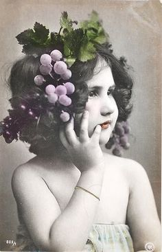 This darling gal, with her grape filled headdress, is just about as cute as they come!