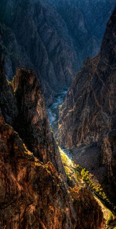 Black Canyon of the Gunnison National Park, Colorado - The Black Canyon is incredibly deep and sheer, with plunging cliffs, soaring buttresses and a thundering river. Greatest depth in the canyon is at Warner Point at 2,722 feet and the narrowest width is 40 feet.