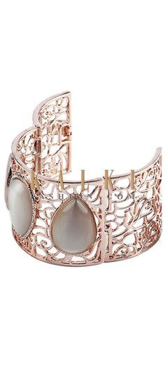 Buy Online from the link below http://www.kalkifashion.com/champagne-mother-of-pearl-cuff.html