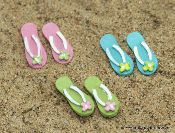 Tiny flip-flops.....even fairies like to relax in the summer. Great site to shop for the fairy garden!