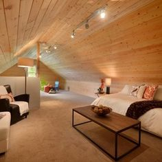Track lighting down the center of the attic.  Eclectic Home Theater by Flow Home Staging & Design