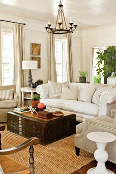 A tufted chesterfield sofa covered in family-friendly Sunbrella fabric adds scale and traditional st... - Photo: Laurey W. Glenn
