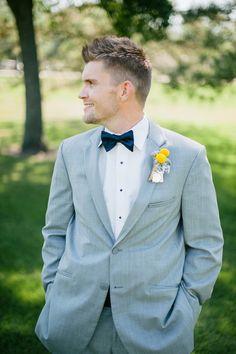 dapper groom #navywedding #yellowwedding #weddingchicks http://www.weddingchicks.com/2013/12/26/navy-and-yellow-wedding-2/