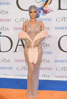 Rihanna gave CFDA Awards attendees an eyeful when she showed up at the event Monday night. See what she wore to pick up the 2014 Fashion Ico...
