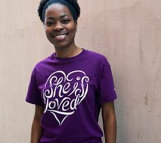 """She is Loved - Purple, Cotton T-shirt - $20, from the Veil of Tears Store. 100 percent of the money received from this T-shirt will go toward Gospel for Asia's """"Hope for Suffering Women"""" fund."""