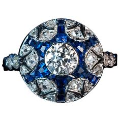 Art Deco Diamond Sapphire Star Ring | From a unique collection of vintage cluster rings at http://www.1stdibs.com/jewelry/rings/cluster-rings/