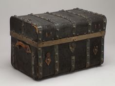 Trunk  Lined with paper with blue and red stenciled floral-like design; plaque in interior drawer engraved: Benjamin Carpenter; inner lid inscribed: CARP.  (Museum of the American West, 89.175.1)