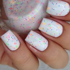 Neon glitter dots from sinney, one coat of G1-2 on top of Gina Tricot White, topped with glossyglam. source