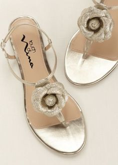 Comfortable yet stylish, these 3D floral sandals are perfect for any occasion! Style Delores at David's Prom.