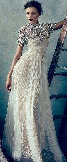 Opt for a beige beaded evening dress for a ridiculously gorgeous look.   Shop this look on Lookastic: https://lookastic.com/women/looks/beige-beaded-evening-dress/22841   — Beige Beaded Evening Dress