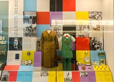 Girl Scout uniforms from 1918 and 1980 on display at the Smithsonian.
