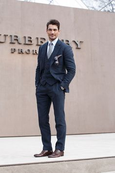 Wearing a Thom Sweeney suit and Russell and Bromley shoes.