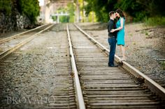 Cute MN engagement picture... Who doesn't love a portrait session on the railroad tracks?