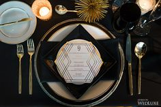 We are in love with the sleek gold and black colour palette of this #tablescape! Modern-meets-Gatsby anyone? | Photography by: Lisa Mark Photography | WedLuxe Magazine | #wedding #luxury #weddinginspiration #tabledecor