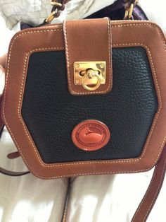 A counterfeit bag that is trying to look like Dooney & Bourke - very bad attempt. FAKE FAKE !