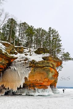 The ice caves near Bayfield, WI have towering evergreens, rock bluffs, and interesting ice formations. Great winter adventure for nature lovers.