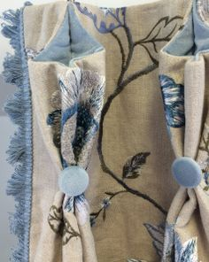 detail of drapery : embroidered floral on linen  with light blue trimmings