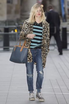 Master of winter street style scores another fashion home run with this laid back t-shirt and jeans ensemble made cosy with a lovely leopard print coat.