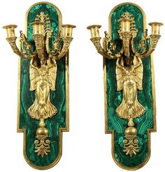A PAIR OF RUSSIAN ORMOLU AND MALACHITE CANDELABRA SCONCES, 19TH C., each with three scrolling branches cast with stylized acanthus leaves, the branches extend from a flower-pot carried by a winged maiden on her head, each on a cartouche-shaped malachite backing, length: 55 cm, LITERATURE: Igor Sychev, 'The Russian Chandeliers, 1760-1830', P.V.B.R, St. Petersburg, 2003, p. 118,