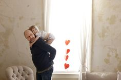 Dad and daughter Valentine piggyback rides.  © Laurie Frankel Photography