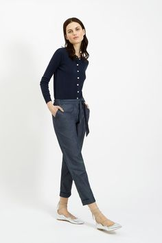 Navy knitted cardigan in 100% organic Fairtrade certified cotton. Shell buttons and long sleeves. Length 54cm.