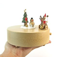 This unique fine-wood crafted music box comes with a miniature Reindeer that circles around a Snowman and Christmas Tree with Santa in his sleigh! It moves to the tune of Jingle Bell Rock! Wooden Music Box, Fun Fair, Santa And Reindeer, Jingle Bells, Good Music, Wood Crafts, Musicals, How To Memorize Things, Miniatures