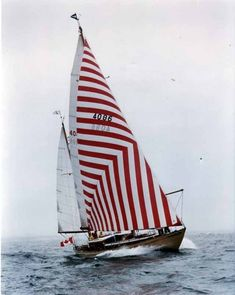 red and white striped sail boat