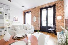 Small apt decor. Loove the brick walls