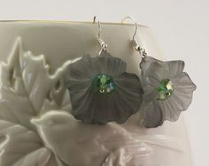 Earrings - Flower (large) Gray Vintage Lucite on Silver ear-wires. These flowers are made of satiny-glossy classic Vintage Lucite in a trumpet-flower motif with a glass crystal emerging at the bottom.                                                                                                                                                                                 More
