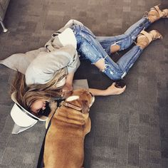 Chrissy Teigen gets on ground level with a dog