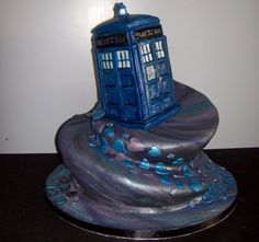 Dr Who cake - with Dalek and a Weeping Angel and maybe a Cyberman and of course a sonic screwdriver on the way up to the TARDIS