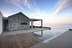 Villa Melana moderna casa de campo revestida en piedra, Grecia - ArQuitexs
