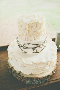 Love this cake! ! !  i like how the layer in the middle has the vine (too dark, looks like barbed wire) and the top and bottom layers are white, but top has flowers and bottom has leaves. Also, cake plate is wood/bark.