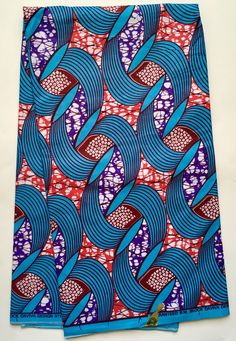 A personal favorite from my Etsy shop https://www.etsy.com/listing/519955037/african-print-fabric-ankara-blue-salmon