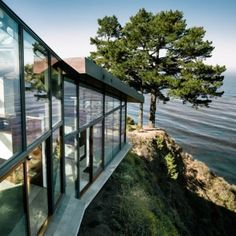 For all the coastal land owners with Beach side properties someting to inspire you, Fall House by Fougeron Architecture  steps down a cliff side