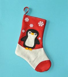 Penguin Christmas Stocking in Red by Allenbrite Studio